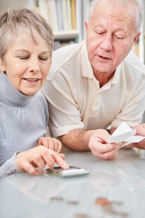 Senior couple checking finance status at home