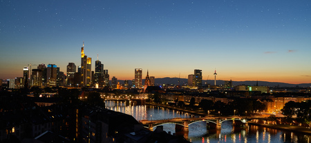 Evening in Frankfurt am Main with illuminated skyline and stars in the sky Фото со стока