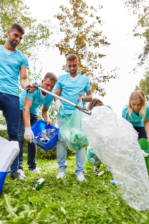 Group of volunteers collects waste and garbage for conservation in the park