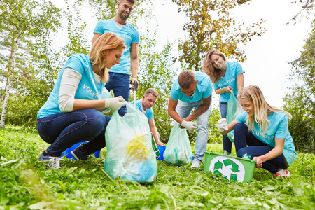 Young people volunteer as garbage collectors at an environmental action