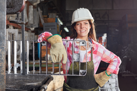 Young woman as self confident blue collar worker