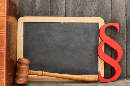 Law and Law concept with blackboard and paragraph and judge gavel
