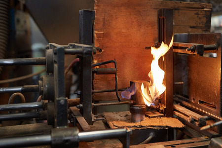 Fire flame from forge machine in metallurgy factory or workshop Zdjęcie Seryjne