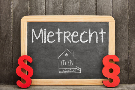German word Mietrecht (tenancy law) as a concept on a blackboard with paragraphs