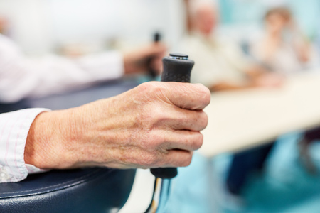 Hands of an old patient with rollator in rehab clinic or nursing home
