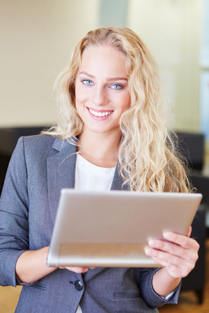 Successful businesswoman works with tablet computer at start-up company Stock Photo