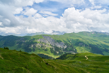 Mountains in the French Alps in summer with clouds in the sky