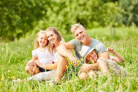 Happy family is relaxing on vacation in green nature