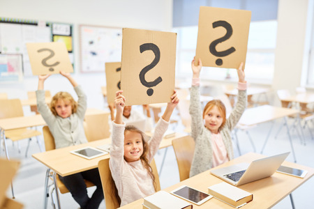 Group of kids in elementary school keeps question mark up where and why