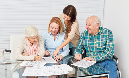 Family with seniors couple together makes memory training as dementia prevention