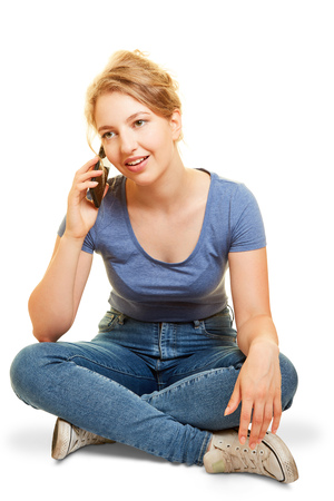 Young woman phoning while sitting with her smartphone
