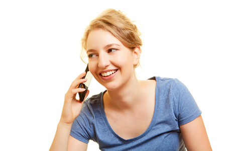 Young blonde woman is phoning with her smartphone smiling