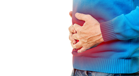 Man with stomach pain keeps his hands on the stomach