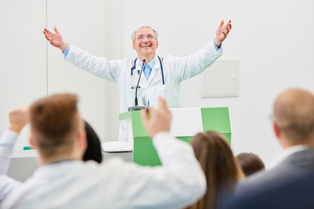 Physician with enthusiasm as happy lecturer after successful medicine seminar