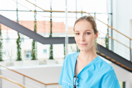 Young woman as physician in surgical nurse apprenticeship at medical school