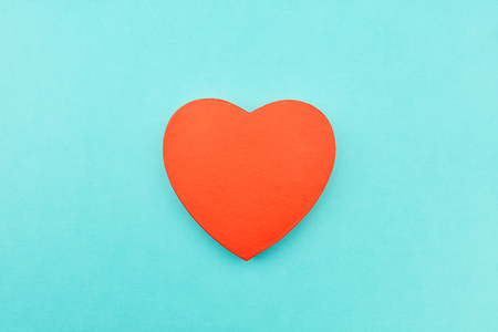 Red heart as a love concept on a blue background Reklamní fotografie