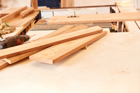 Boards on a workbench in a carpentry or cabinet-making workshop