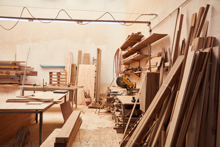 Empty workshop in a joinery with wood warehouse and workbench