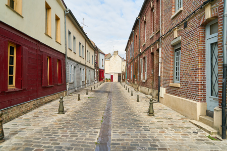 Empty narrow street during the day in the historic center of Amiens, France