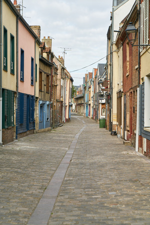 Many old colorful houses line an alley in the old town of Amiens, France Stock Photo