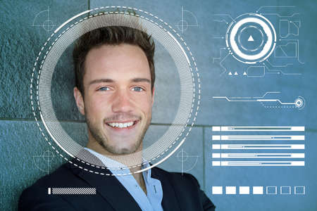 Face recognition of young businessman by AI for identification and security