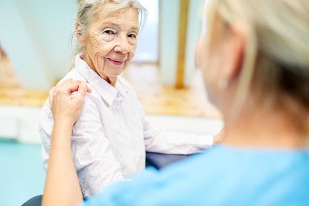 Nursing cares for a senior citizen as a patient with dementia Stock Photo