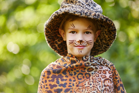Boy dressed up like leopard after pace painting exceperience