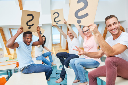 Creative startup team with question mark celebrates an idea during brainstorming
