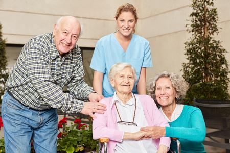 Group of seniors with geriatric nurse in nursing home or nursing home