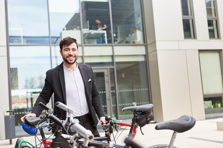Business man as a climate-friendly cyclist and commuter by bike