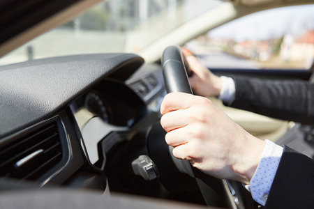 Motorists have their hands firmly on the steering wheel as a symbol of concentration Banque d'images - 121134327