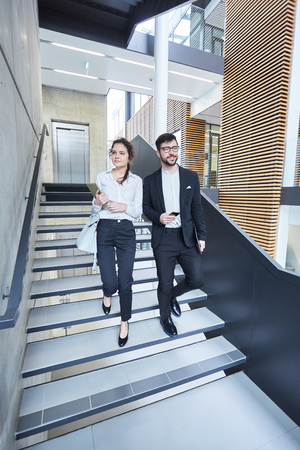 Businessman and businesswoman as colleagues on the road in the group staircase Banque d'images - 121134328