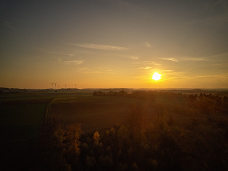 Sunset in front of landscape with wind turbines in Bavaria in autumn Banque d'images - 121134429