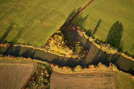 Canal with water through fields in autumn Banque d'images - 121134433