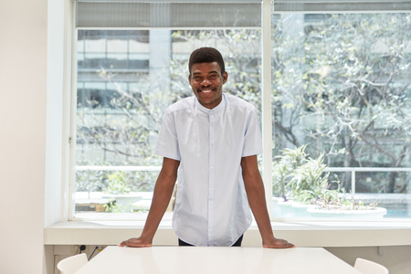 Young African man as a student or intern in seminar room or office Banque d'images - 121134639