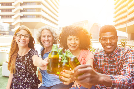 Friends toasting at a party with a bottle of beer Banque d'images - 121134643