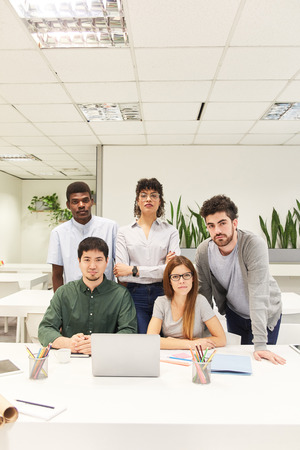 Multicultural business start-up team in coworking office at laptop computer Banque d'images - 121134723