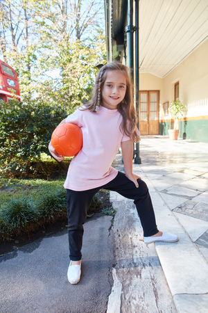 Girl in childrens leisure or vacations plays with a ball Zdjęcie Seryjne
