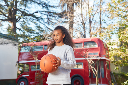 Girl is looking forward to basketball game training at summer camp
