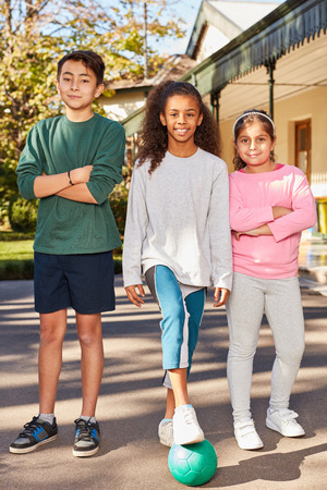 Three students as friends in physical education multicultural school Stockfoto - 121397122