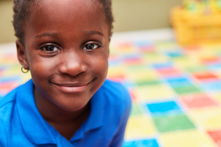 Smiling african girl in kindergarten or elementary school as a pupil