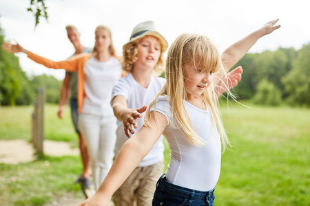 Family and kids exercise fitness and balance on trim path