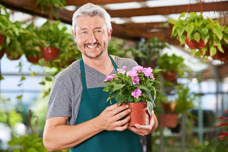 Mann works as a florist in the garden center and sells plants