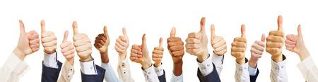 Geschäftsteam mit Daumen hoch als Erfolgskonzept Standard-Bild