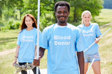 Young volunteers campaign for blood donation with a stand