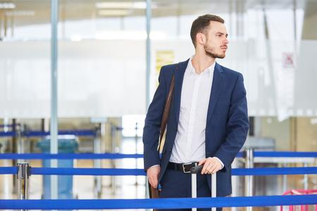 Impatient business man in airport terminal on business waiting for departure Reklamní fotografie