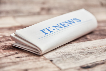 IT News newspaper with technology news on wood