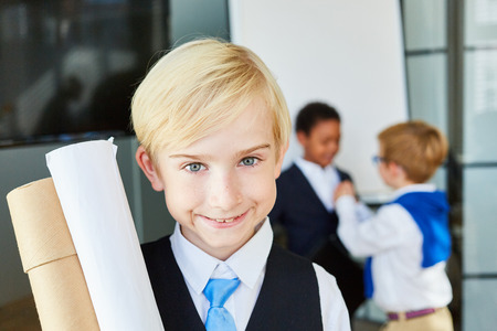 Smiling kid as a successful businessman or lawyer in the office Reklamní fotografie