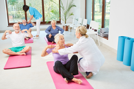 Senior course is doing physiotherapy and rehabilitation in the nursing home under the guidance of therapists Stock Photo