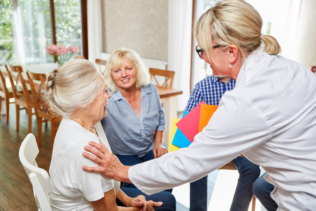 Psychotherapist looks after seniors in a group therapy session
